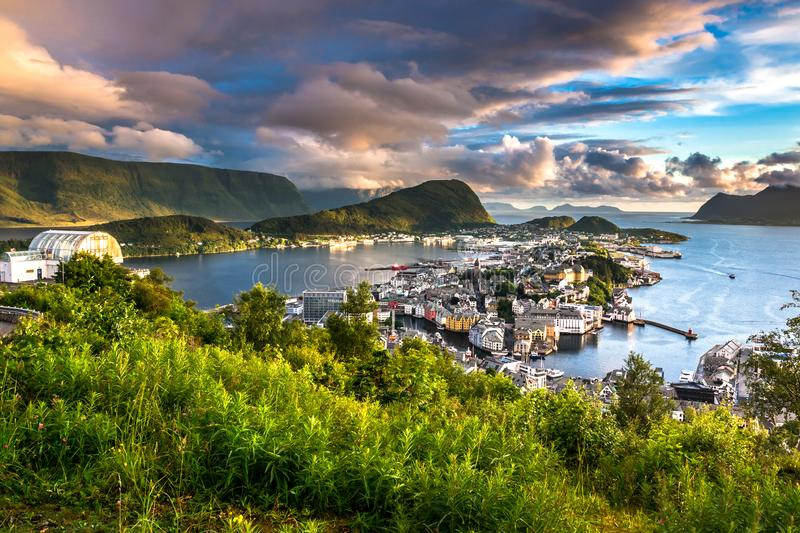 City Scene with Aerial View of Alesund Center at Colorful Dusk. Image of Alesund at beautiful sunset in Summer taken from Mount Aksla Viewpoint. Alesund is a royalty free stock images