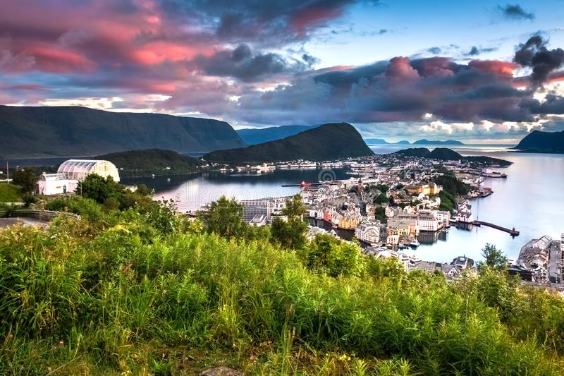 City Scene with Aerial View of Alesund Center at Colorful Dusk. Image of Alesund at beautiful sunset in Summer taken from Mount Aksla Viewpoint. Alesund is a stock image