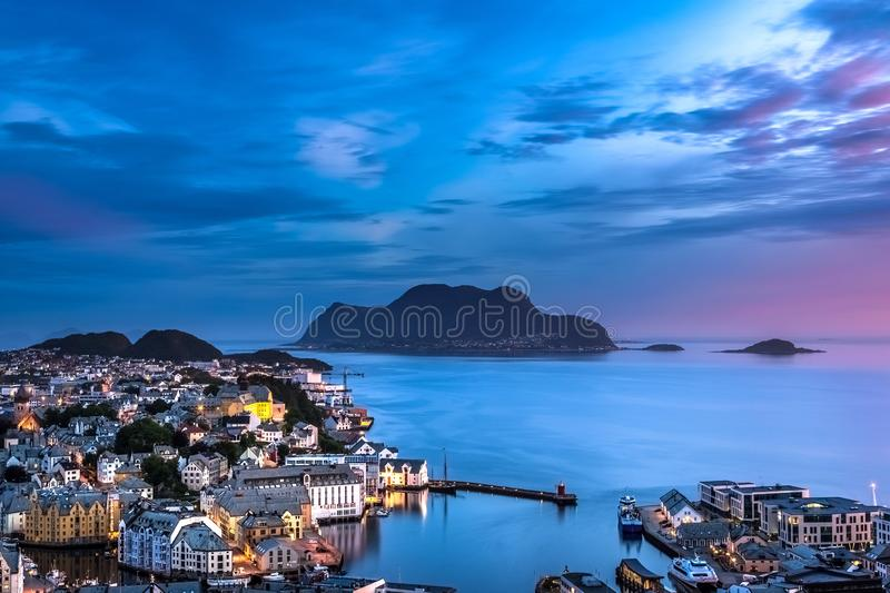 City Scene with Aerial View of Alesund Center, Islands and Atlantic Ocean after Sunset. Image of Alesund after sunset in Summer taken from Mount Aksla Viewpoint stock photography