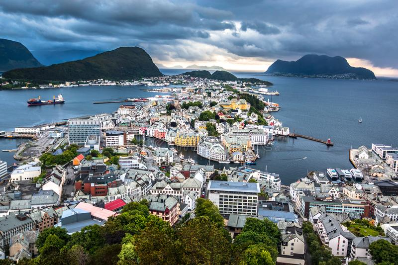 City Scene with Aerial View of Alesund Center After The Rain. Image of Alesund after the rain in Summer taken from Mount Aksla Viewpoint. Alesund is a port town stock photos