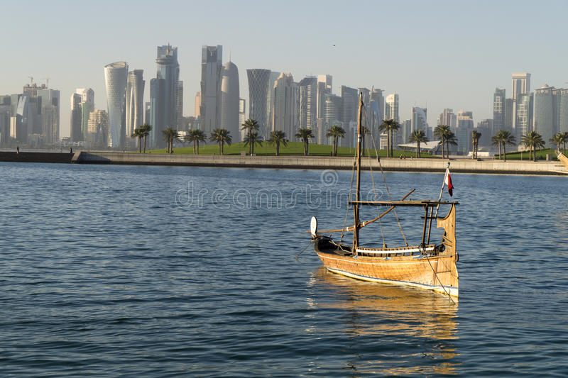 City scene at daytime. Doha city at day time with a small boat onward to the city royalty free stock photography