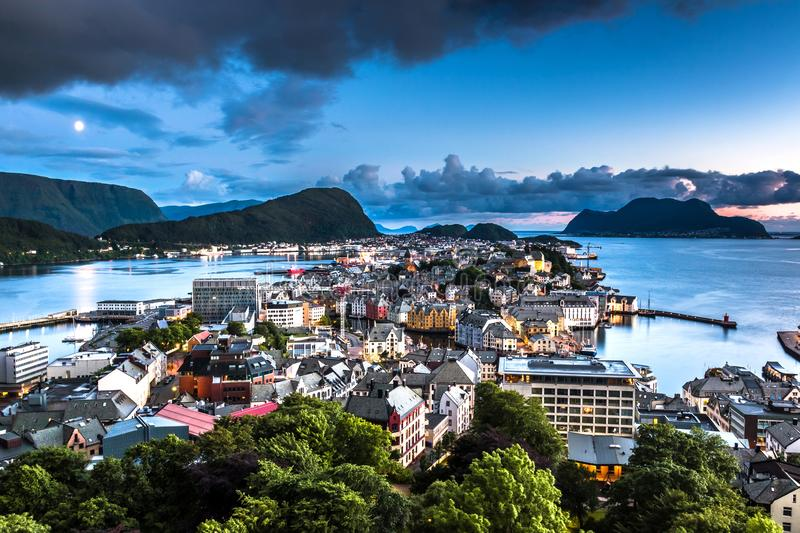 City Seascape with Aerial View of Alesund Center by Night. Image of Alesund after midnight in Summer taken from Mount Aksla Viewpoint. Alesund is a port town on stock image