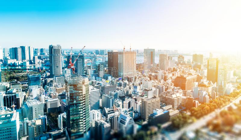 City skyline aerial view in tokyo, japan with miniature lens tilt shift blur effect stock photos