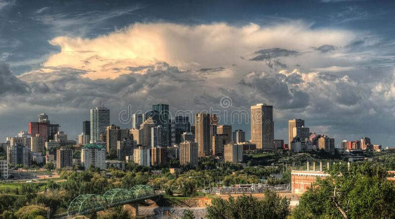 City skyline against cloudy skies royalty free stock image
