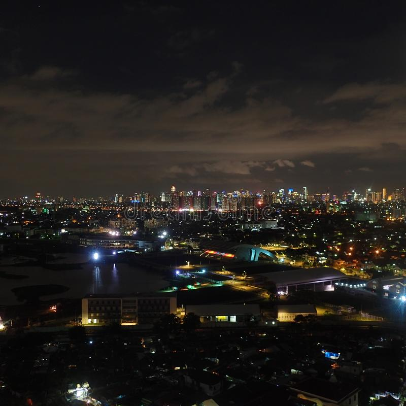 City skyline at the evening. Jakarta skyline at evening over a small lake and colorfully lighted buildings stock photography