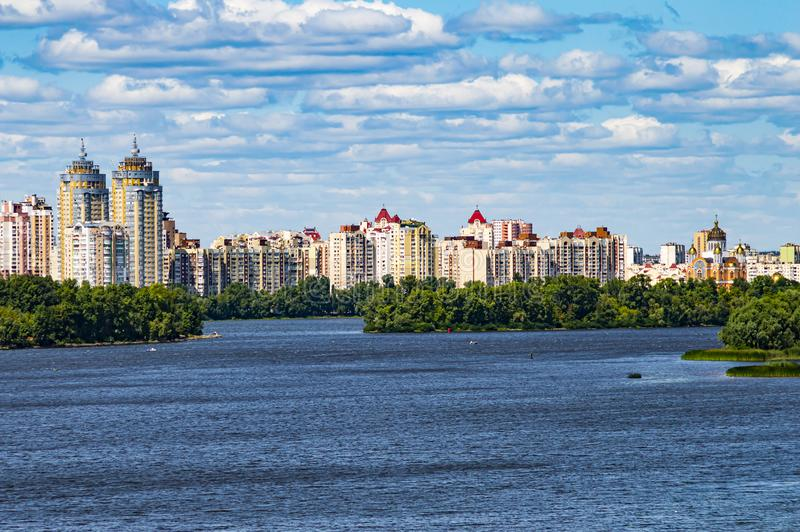 City skyline over the river against the blue sky stock photo