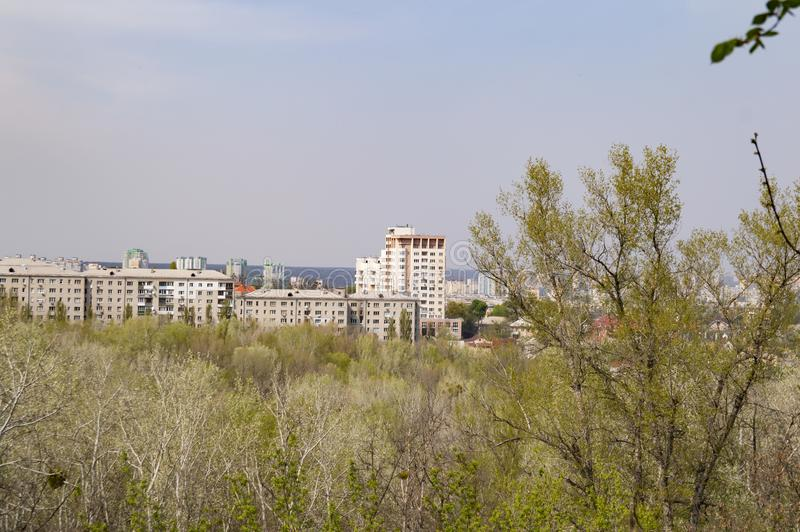 City skyline over trees from a bird`s-eye view stock image
