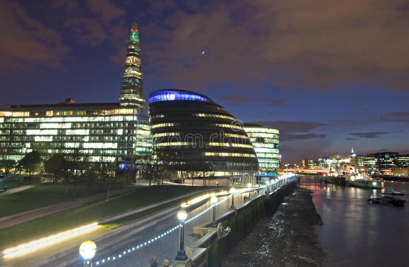 London city hall and skyline at night. City skyline and River Thames iluminated by lights, including the Shard building and Mayors City Hall stock image