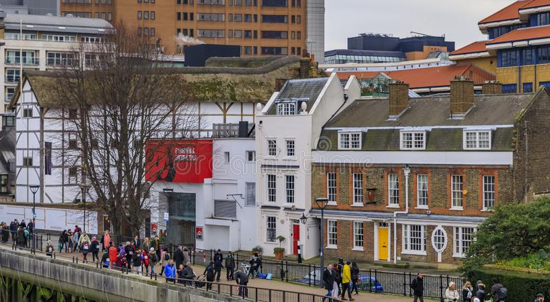 City skyline with the Shakespeare's Globe Theatre on Thames river bank in Bankside, London, England. London, England - January 14, 2018: City skyline with the royalty free stock images