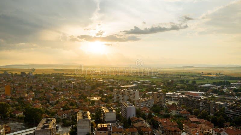 City skyline during storm at sunset. City skyline during storm, Karnobat, Bulgaria royalty free stock photo