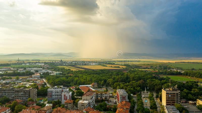 City skyline during storm at sunset. City skyline during storm, Karnobat, Bulgaria royalty free stock photography