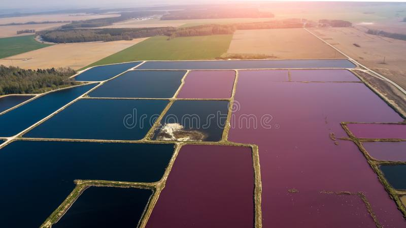 City station for wastewater treatment. A lot of ponds with dirty and cleaned water. Aerial view stock image