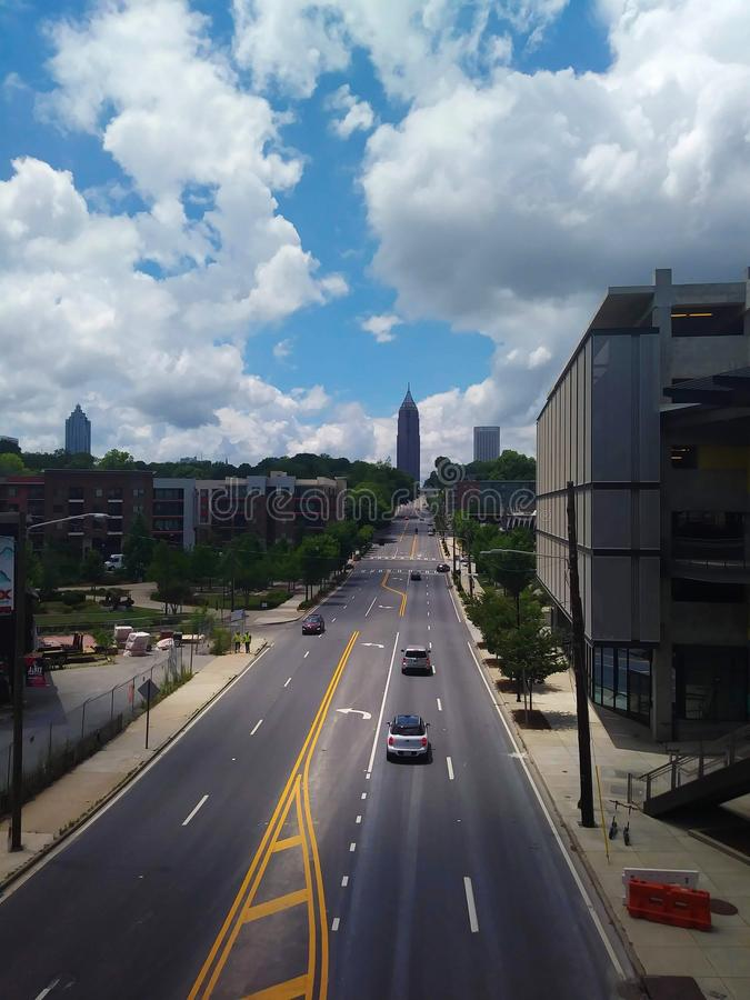 City Street, Atlanta, Georgia. Cities, streets, road, roads, urban, view, views, blue, sky, skies, cloud, clouds, downtown, midtown, skyline, cityscape stock image