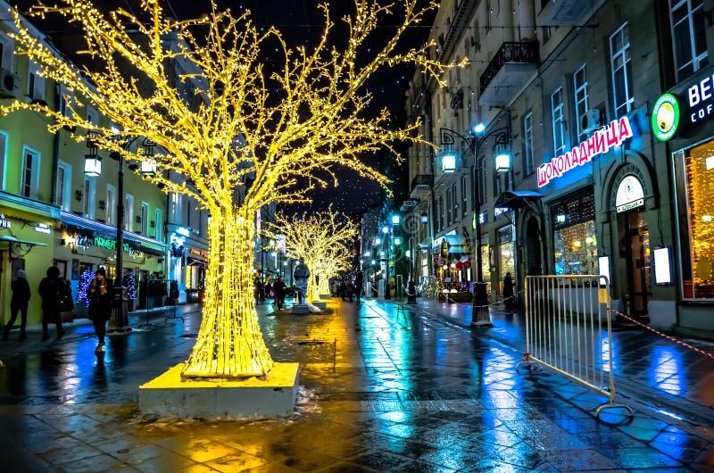 City street illuminated at night royalty free stock images