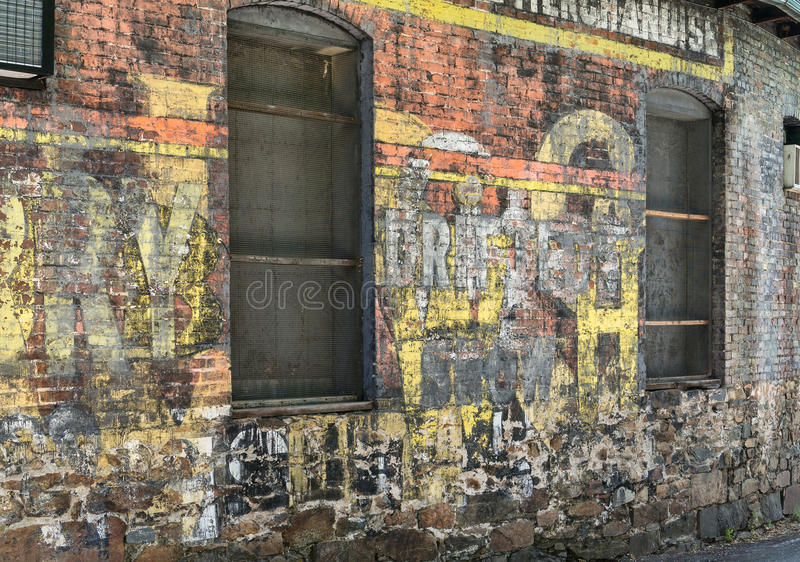 City street painted wall. Colorful advertising covers a city wall royalty free stock photos