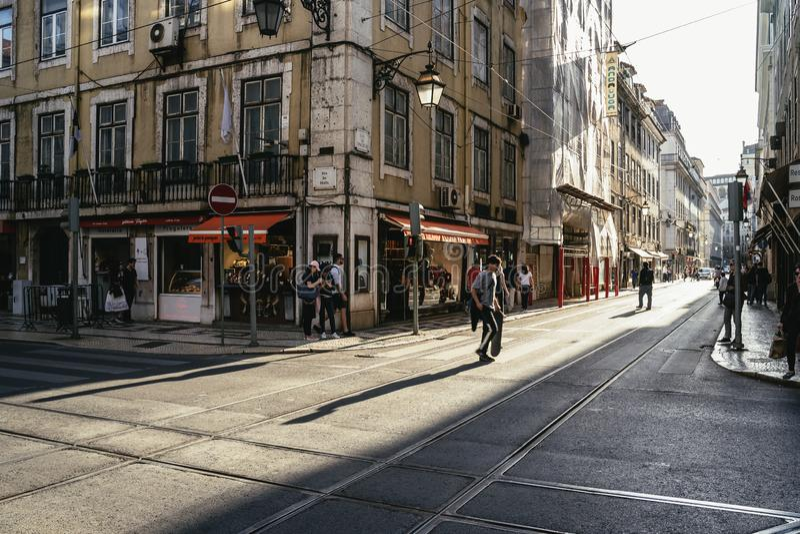 City street scene in the historical area of Alfama royalty free stock photo