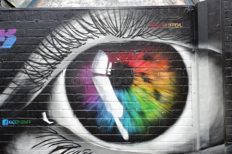 City Street Urban  Wall Art Eye Painting. Manchester England. Detail of inner city street art wall with painted mural of an eye stock photography