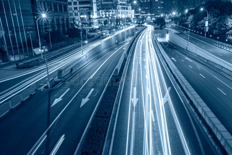 City streets in the night and the car light track royalty free stock photos
