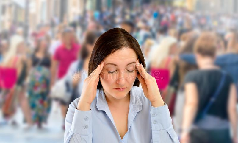 The city stress. Woman with severe headache with fraud on the city royalty free stock images