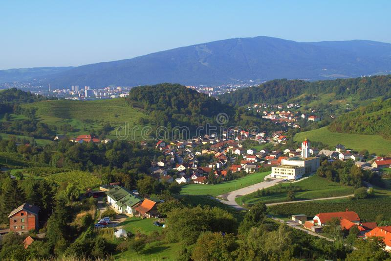 Košaki, Maribor, Slovenia. City suburb Košaki near Maribor, Slovenia with modern church, vineyards and Pohorje mountain in the background in late summer royalty free stock image