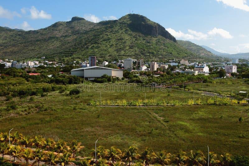 City suburbs at mountain foot. Port Louis, Mauritius. 09-01-2016 stock photography