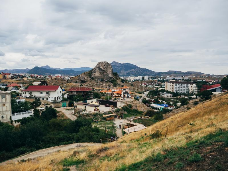 City of Sudak in Crimea on holiday in the summer. City of Sudak in the Crimea on holiday in the summer in cloudy weather royalty free stock photo