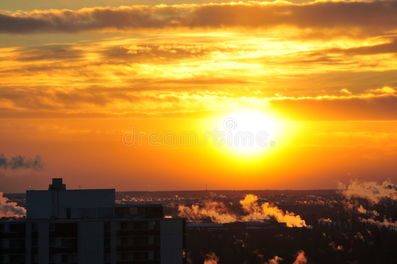 City and sunset royalty free stock image