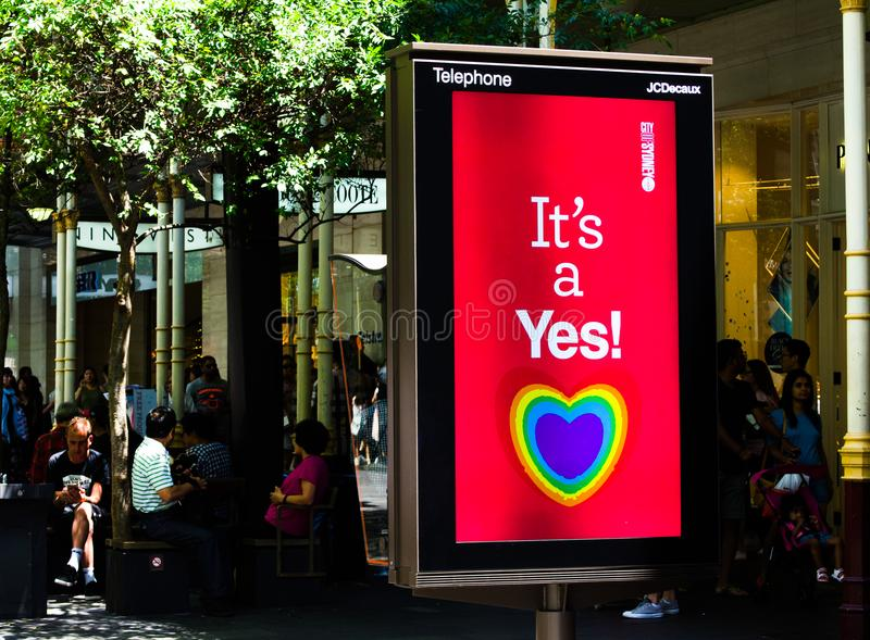 The city of Sydney council supporting same-sex marriage with heart rainbow on a screen monitor says `It `s a Yes!` banners. stock photo