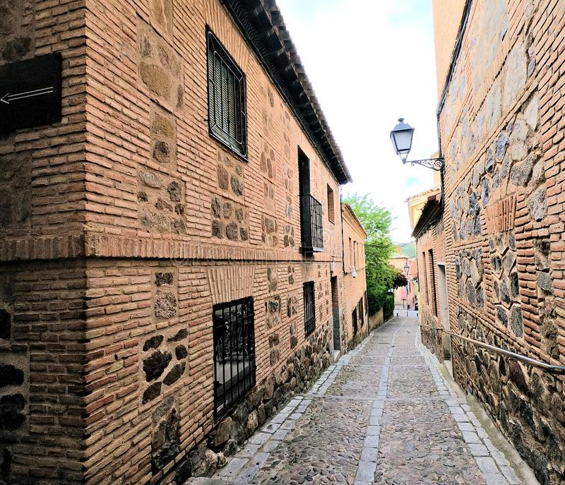 City of Toledo Spain. Narrow stone road between houses in Toledo Spain stock photos
