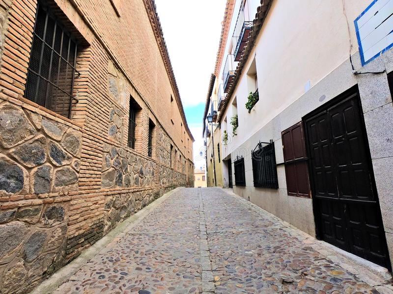 City of Toledo in Spain. Narrow stone road between houses in Toledo Spain royalty free stock images