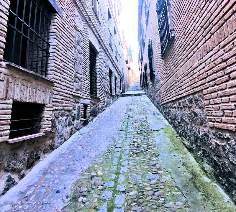 City of Toledo Spain. Narrow stone road between houses in Toledo Spain stock photography