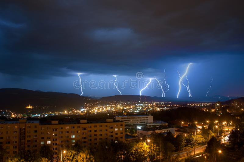 City town night storm lighting thunderstorm stock photography