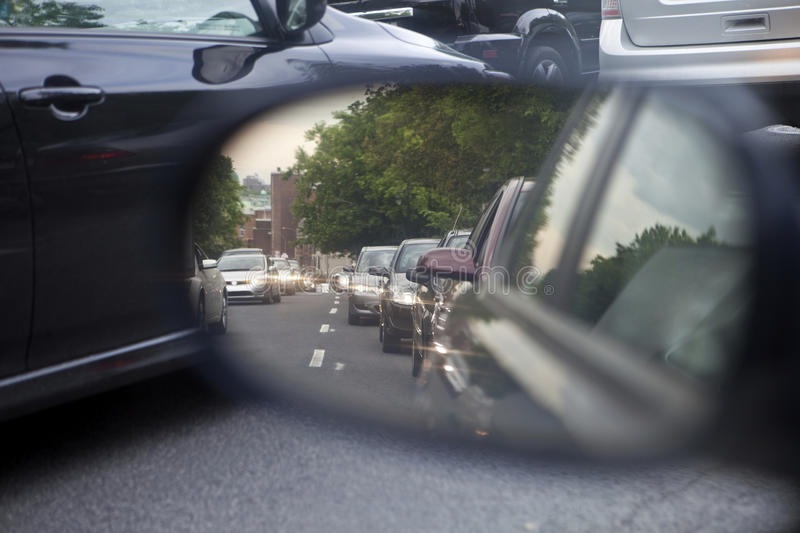 City traffic congestion. In mirror and in front stock images