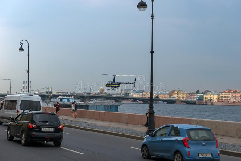 City traffic and landing a helicopter on a floating platform on the Neva River royalty free stock photography
