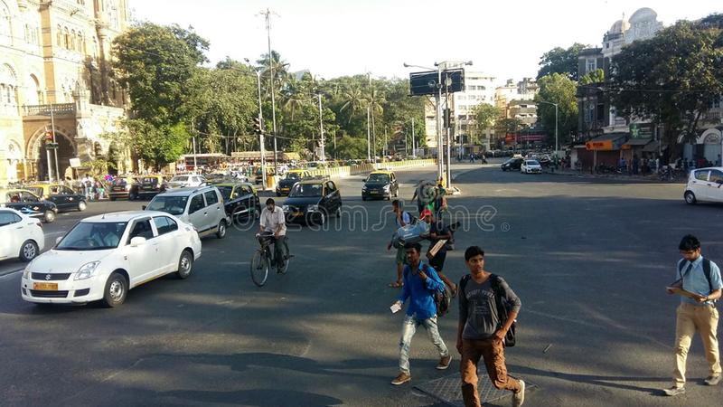 City traffic pedestrian crossing road Mumbai, India. MUMBAI, INDIA - MAY, 2018 - Traffic in India`s largest city royalty free stock photo