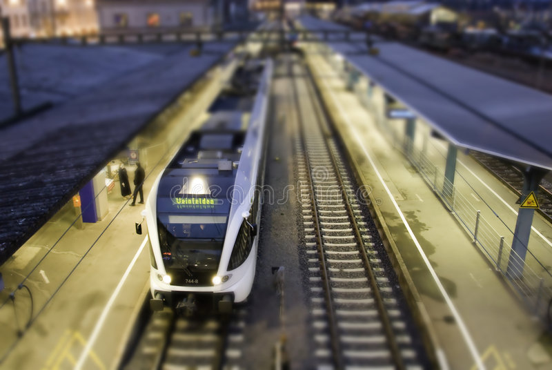 City train on tracks. With blurred city background stock photo