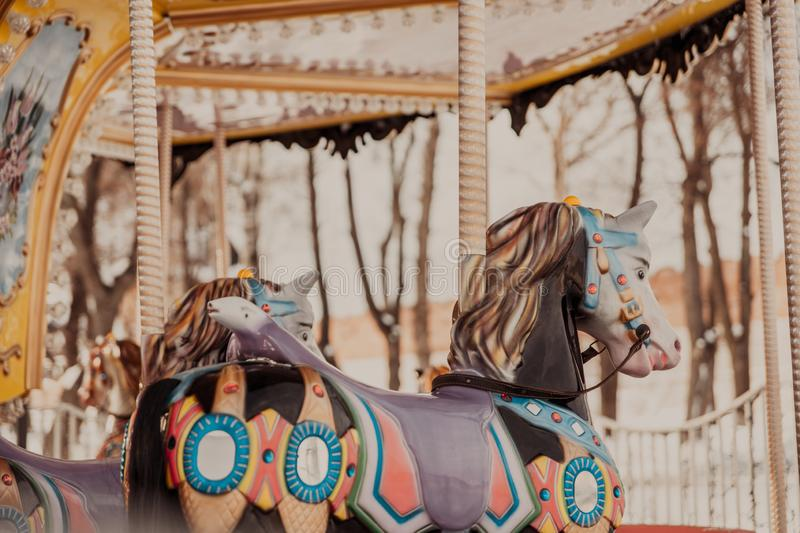 City Tula. Russia - January 19, 2019:Children`s carousel with horses without children. stock image