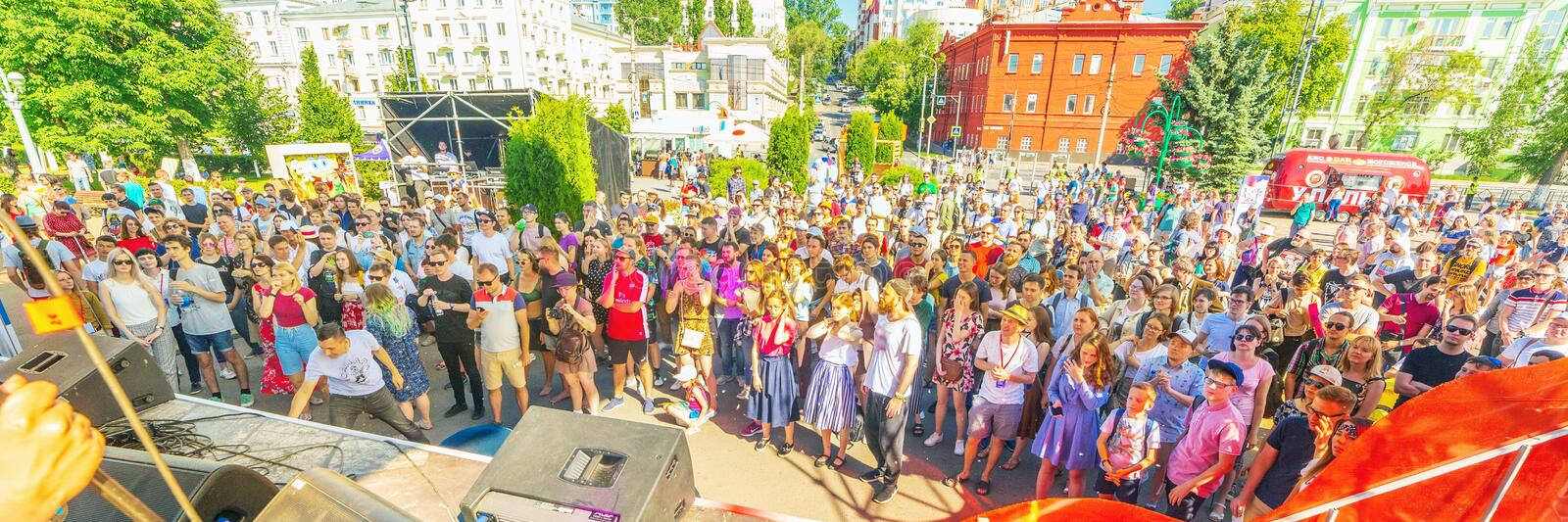City vacationers watch a musical performance in the open air. Russia, Samara, June 2019. City vacationers watch a musical performance in the open air royalty free stock images