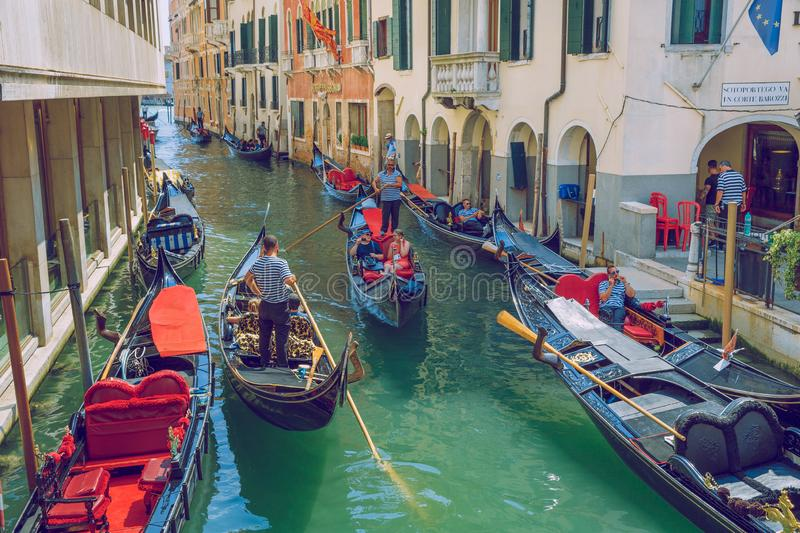 City Venice, Italy republick.  tourists in a gondola ride along a canal with a boat. Godolier and peoples. 4 August 2016 royalty free stock photo