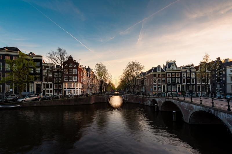 City view of Amsterdam, the Netherlands with Amstel river during sunset stock images