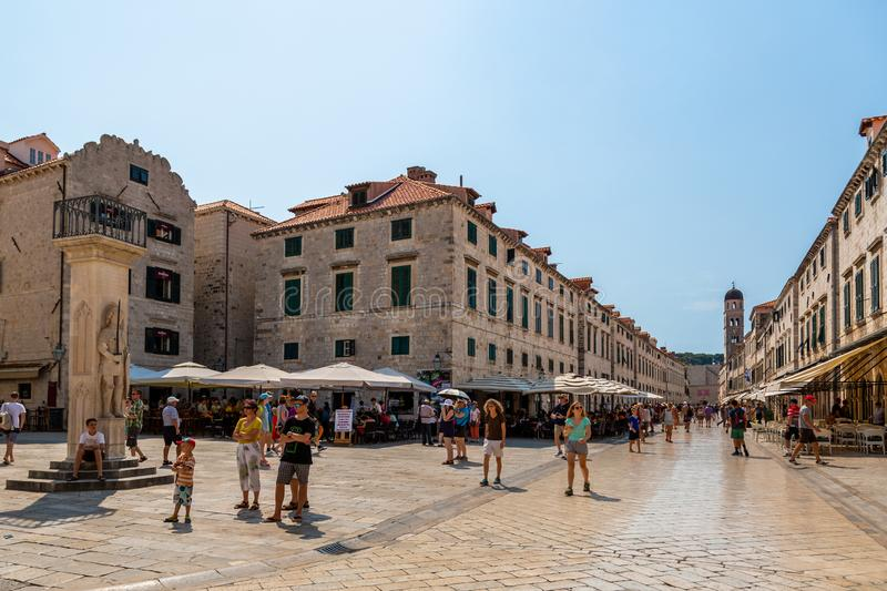 City view of buildings and people in the old town at the town square and along the main street in Dubrovnik. stock photos