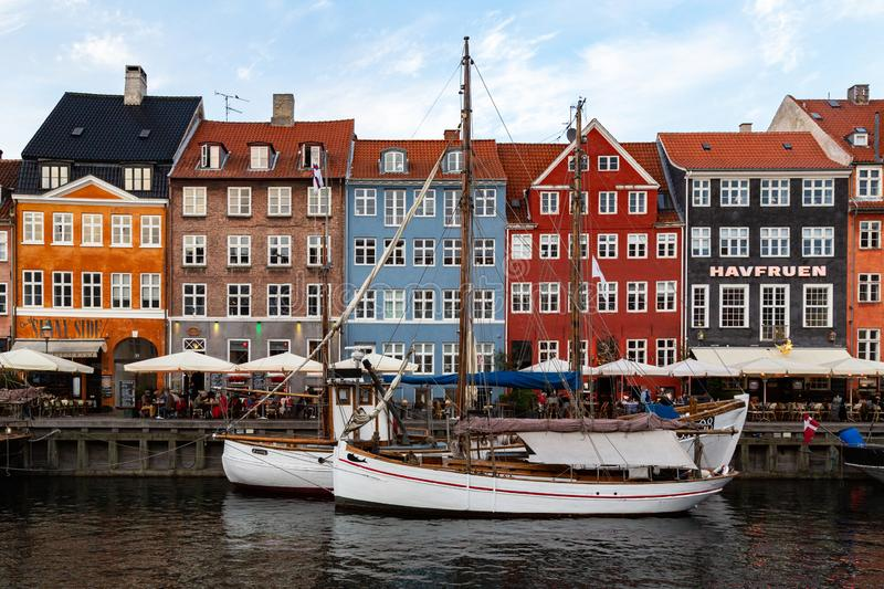 City view of Nyhavn, the canal district in Copenhagen, Denmark. The canal leads out to Copenhagen`s harbor. Nyhavn is a busy tourist area line with historic stock photos