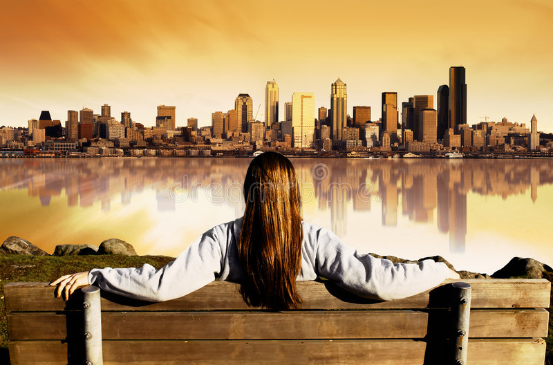 City View Sunrise. Girl looking at the City of Seattle
