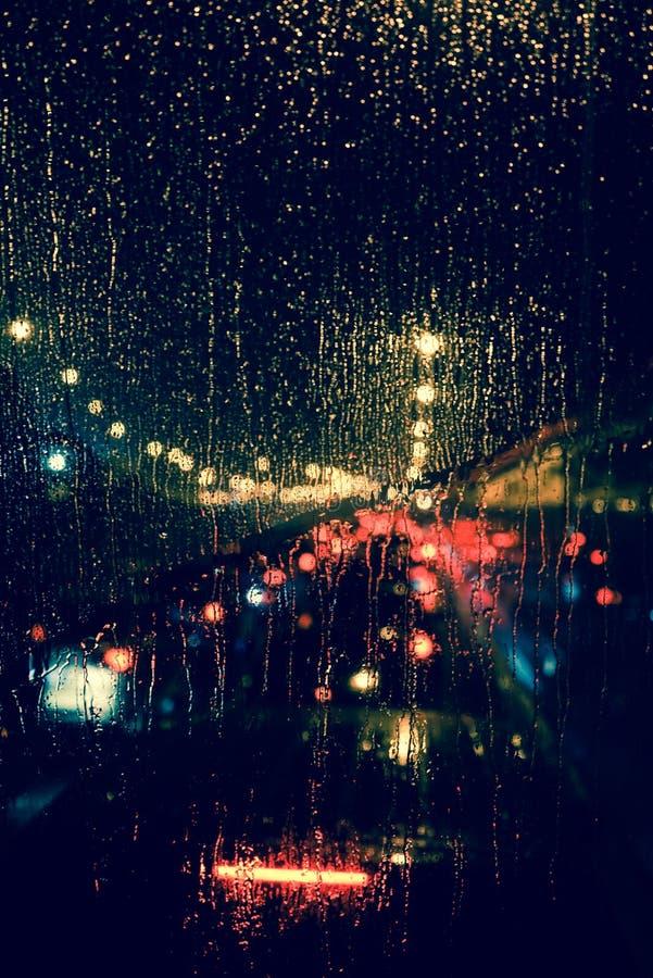 Free City View Through A Window On A Rainy Night Stock Image - 77412871