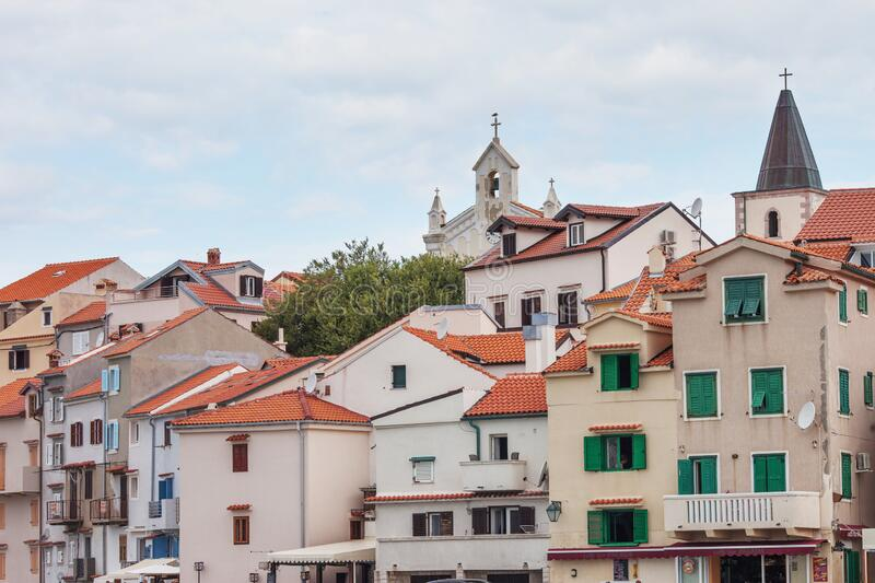 City view of traditional sea town in Croatia  with red tiled roofs and light  houses royalty free stock photos