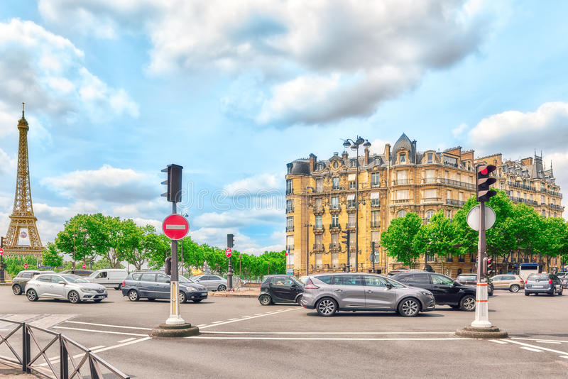 City views of Paris. PARIS, FRANCE - JULY 06, 2016 : City views of one of the most beautiful cities in the world-Paris. Street, buildings, Eiffel Tower in the royalty free stock image