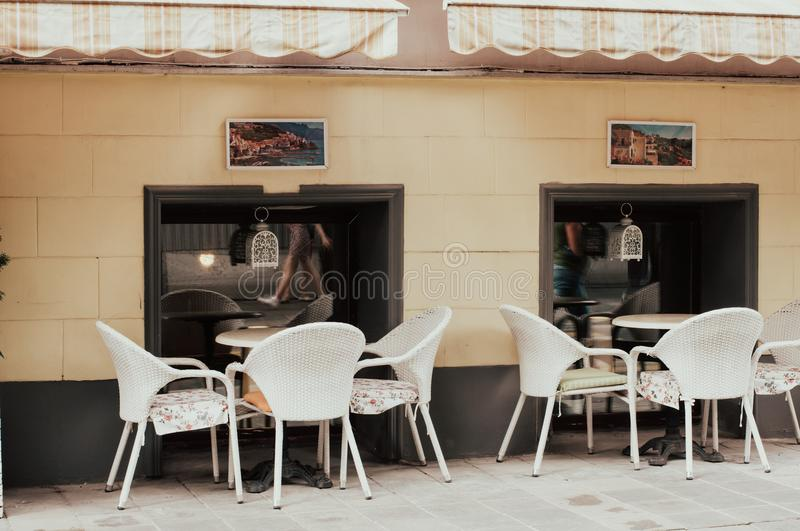 City vintage cafe in the street. Restaurant exterior and interior stock photos
