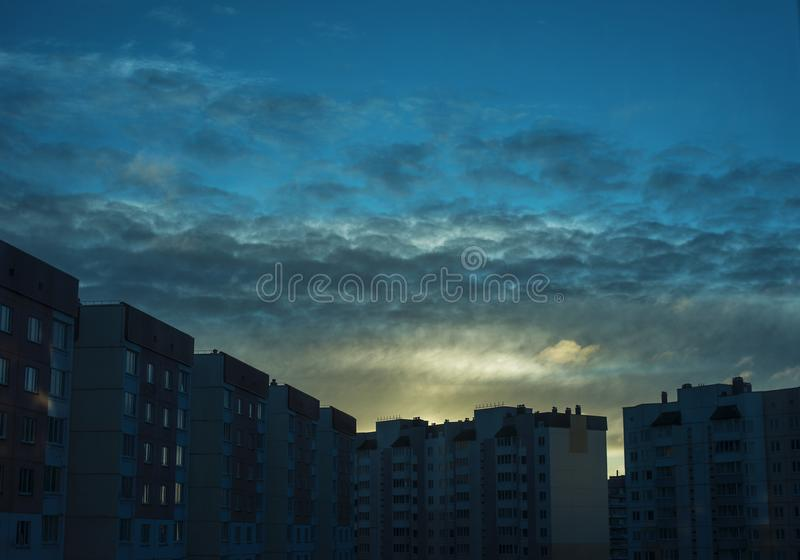 The city wakes up in the first rays of the sun wakes up royalty free stock photography