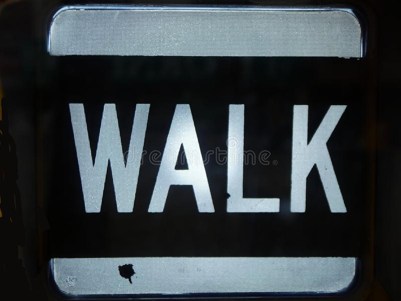 City: Walk sign. White Walk pedestrian crossing sign detail royalty free stock photo