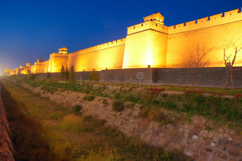 City wall. The nightscape of Pingyao City Wall in Shanxi, China. The city wall was built in ancient Chinese Ming Dynasty royalty free stock images